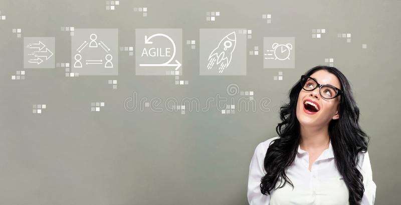 Agile concept with young businesswoman. In a thoughtful face stock photos