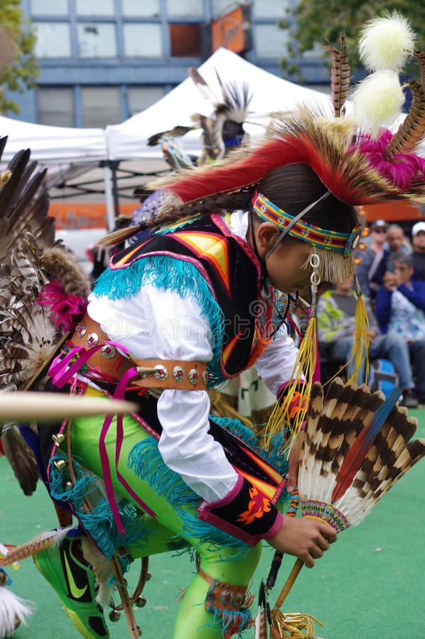 Agile movements of a young Pow-wow dancer royalty free stock image