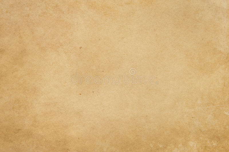 Aging paper texture or background. Old yellowed paper background for the design stock photos