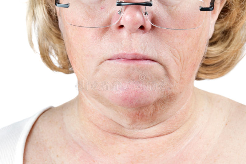 Aging skin. Mature woman's lower face and neck showing the aging process stock photos