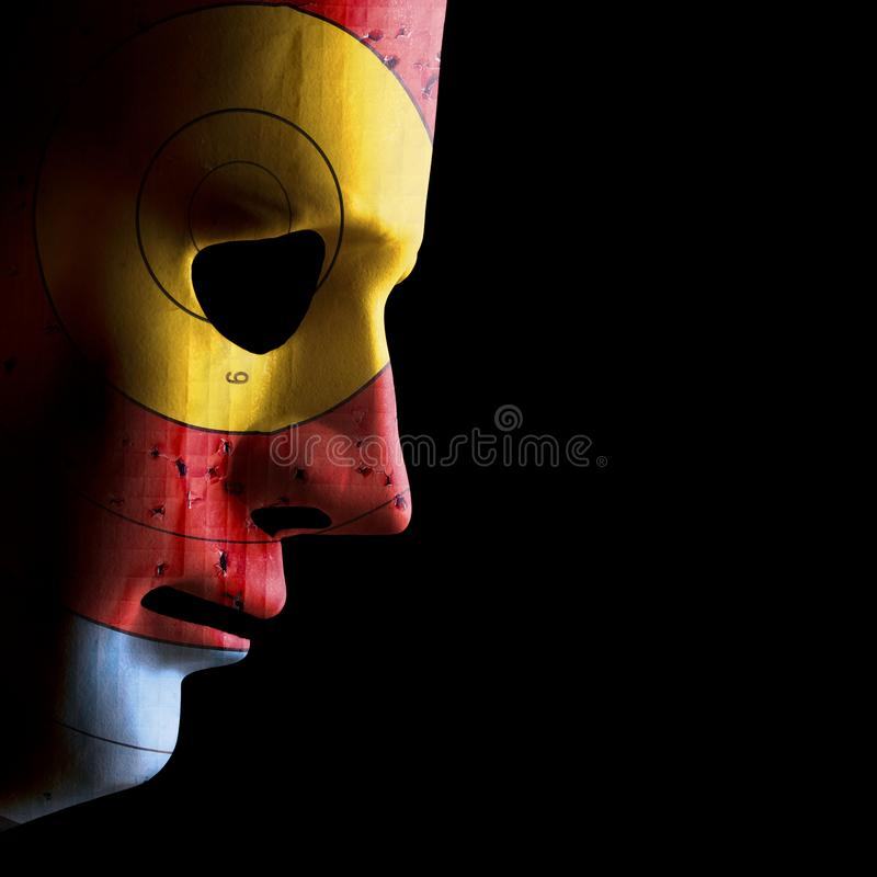 Aging skin concept with used target. Side view of a scary halloween face mask with a used archery target as skin. Concept of target skin conditions. Black copy royalty free stock photo