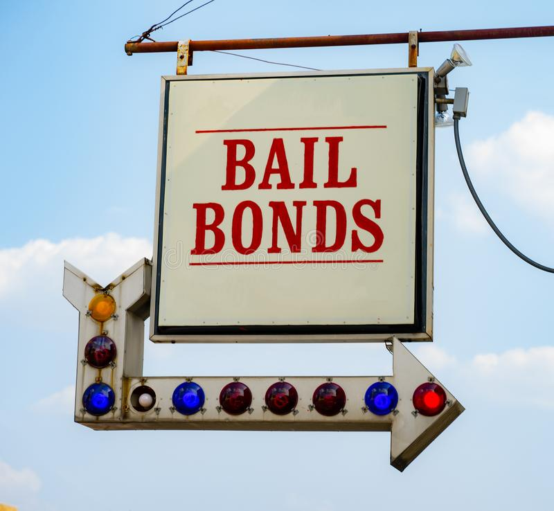 Aging Vintage Sign in Front of Samll Town Bail Bonds Office stock photos