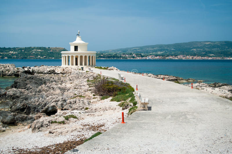 Agion Theodoron Lighthouse. (Fanari Lighthouse) near Argostoli, Greece. The lighthouse was originally built in 1828 during the British occupation. It was ruined royalty free stock images
