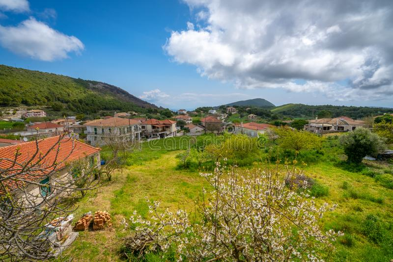 Agios Leon village homes in Zante. View of the green countryside of the interior of Zante or Zakynthos Island with red tiled rooftops of homes in Agios Leon stock photo