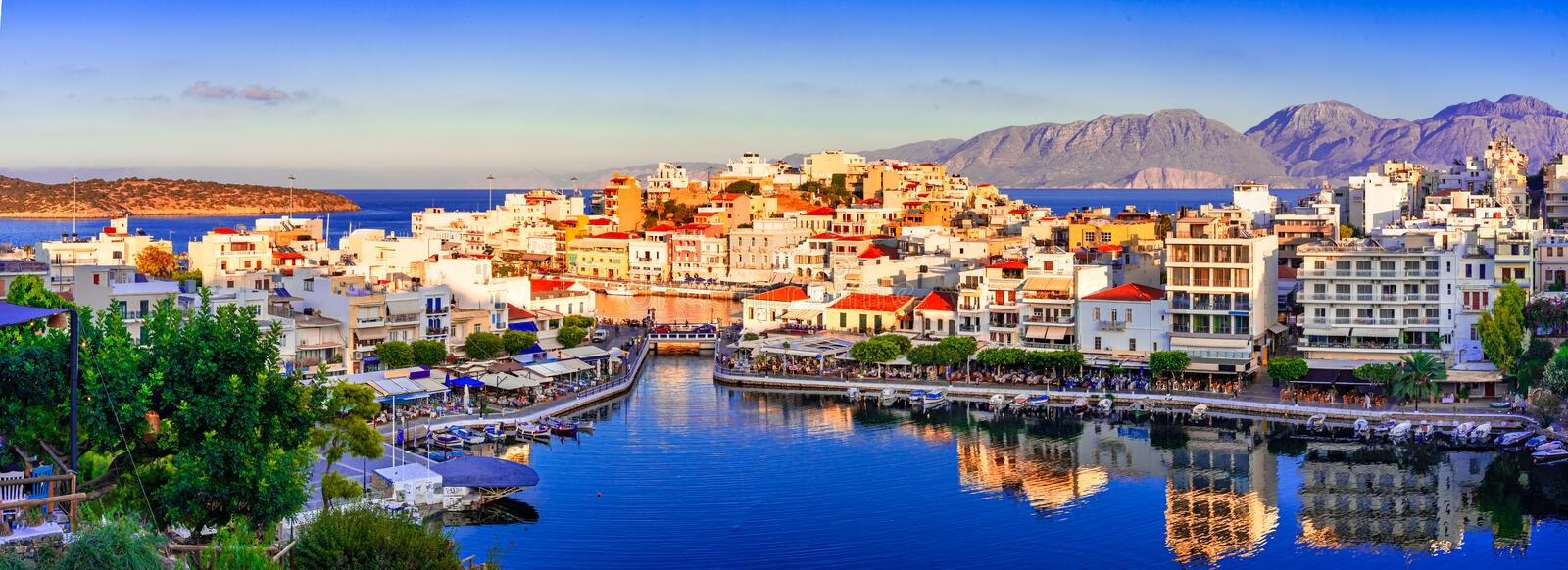 Agios Nikolaos, Crete, Greece: Sunset view of Agios Nikolaos over Voulismeni Lake, a picturesque town in the eastern part of the royalty free stock photography