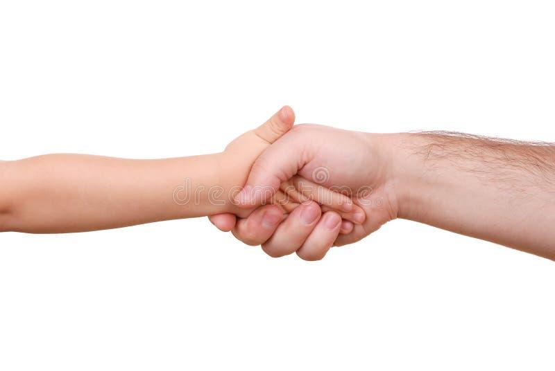 Agitação da mão da criança e do pai imagem de stock royalty free