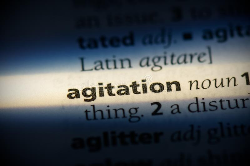 Agitation. Word in a dictionary.  concept, definition royalty free stock photography
