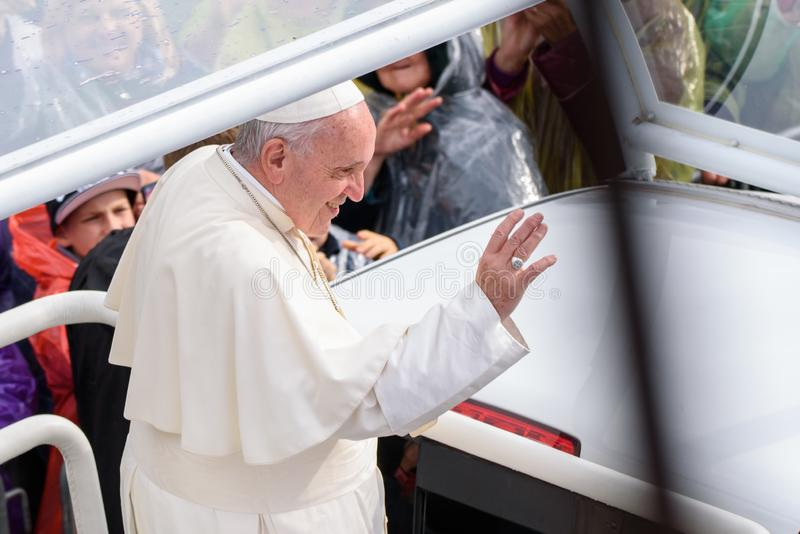 His Holiness Pope Francis waving to crowd at Pope Mobile. 24.09.2018. AGLONA, LATVIA. His Holiness Pope Francis, during Holy Mass at Aglona Basilica stock photos