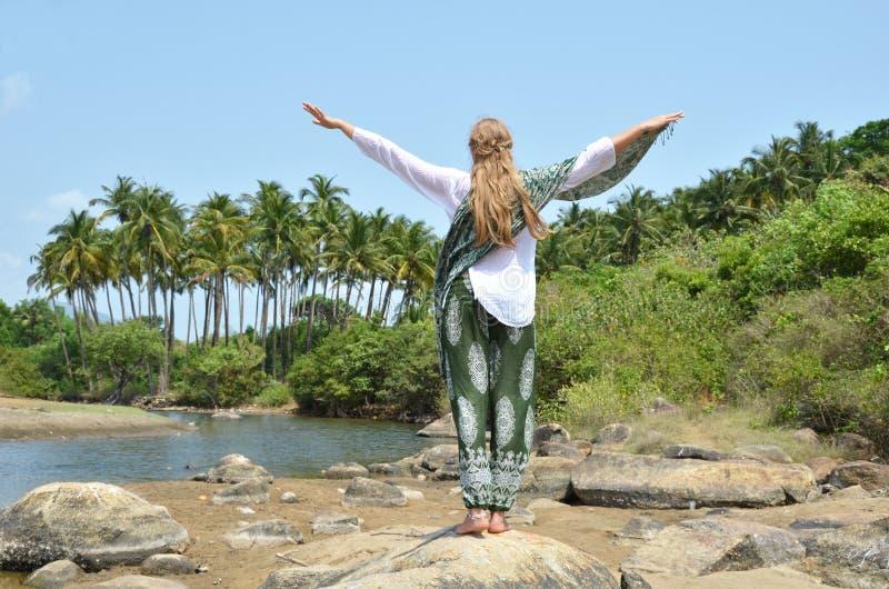 Agonda beach. Goa, India. Young woman meditating on Agonda beach. Goa, India royalty free stock image