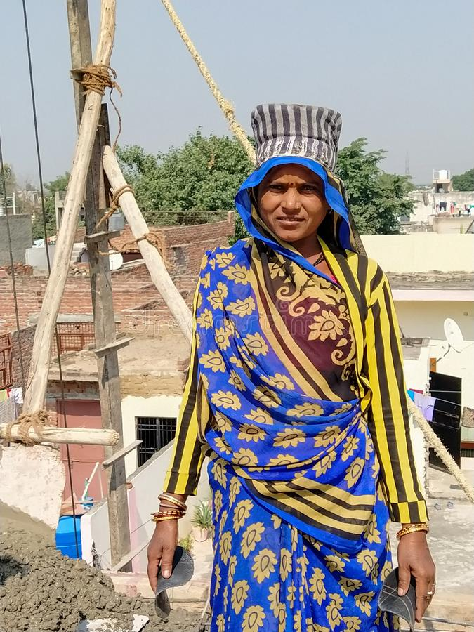 Agra- up- India- November 4, an indian women standing on the roof royalty free stock image