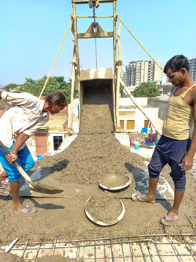 Agra- up- India- November 4, two men working at the construction site royalty free stock image