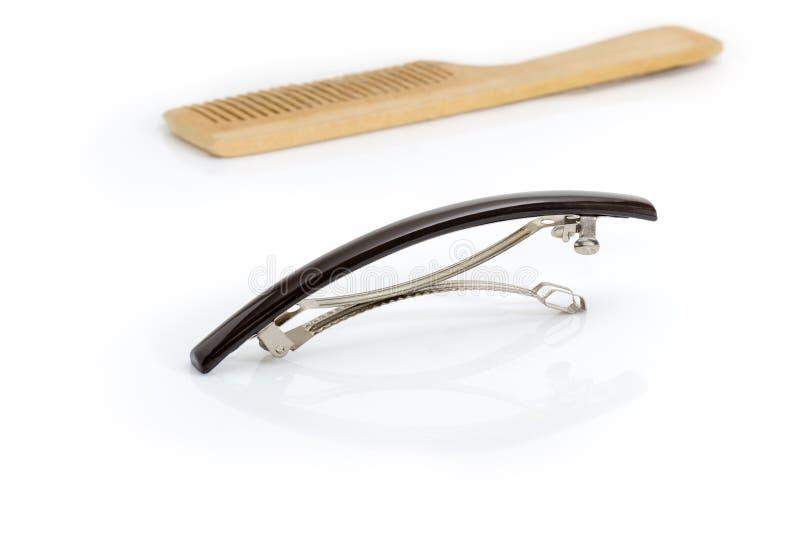 Agrafe de cheveux française de barrette sur un fond brouillé de peigne photographie stock libre de droits