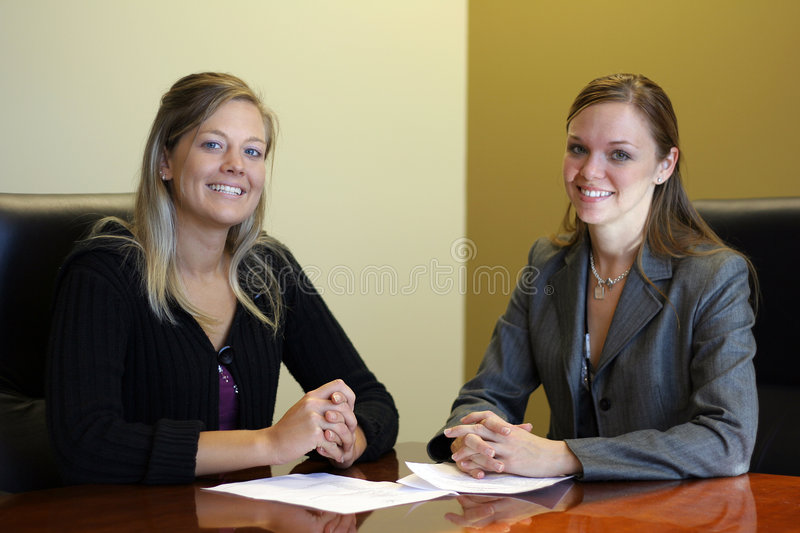 Agreement. Two women in a meeting reached agreement stock images