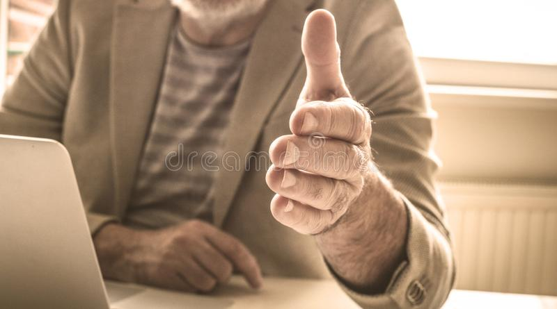 Agreement is concluded. Success business need a shaking hand. Close up. Focus on hand royalty free stock photos