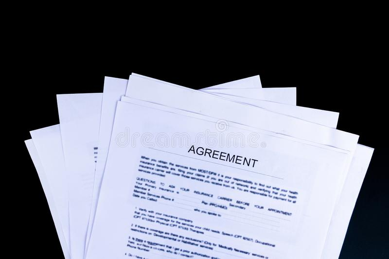 Agreements Documents Papers with black background and top view, royalty free stock photography