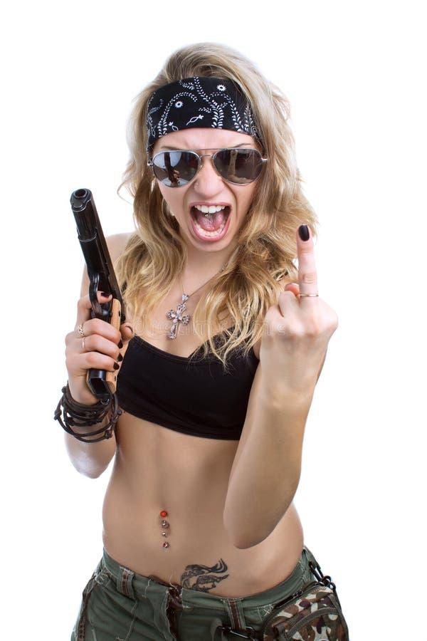 Agressief meisje met een kanon stock fotografie