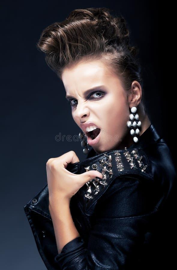 Agression - ohyfsad negativ ilsken kvinnlig royaltyfria foton