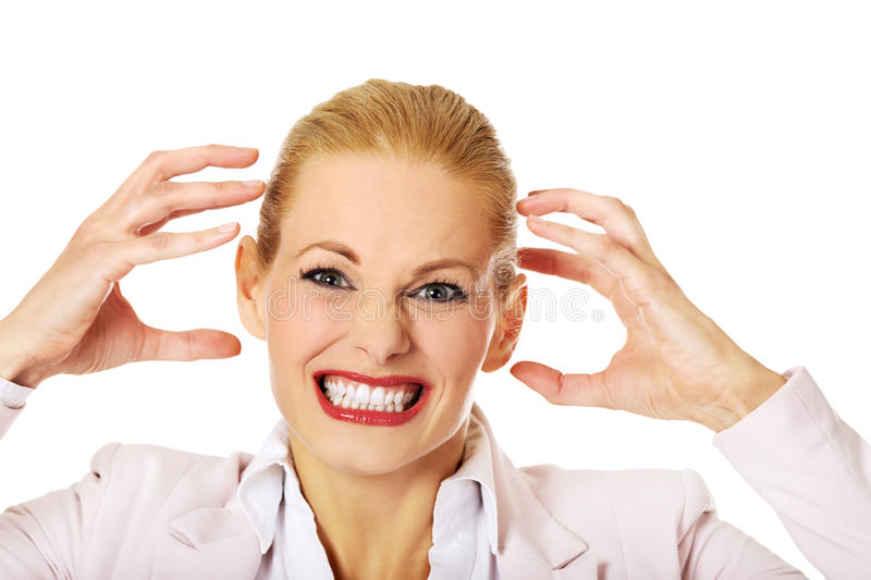Agressive young business woman screaming stock photo