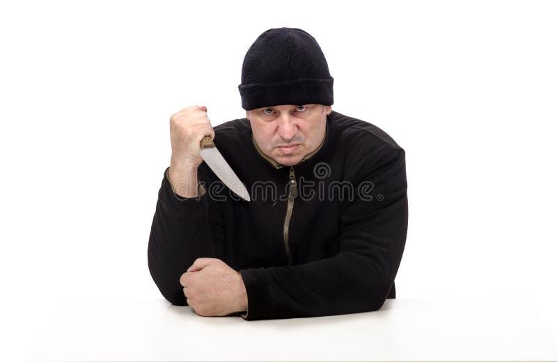 Agresywny psychopata z dużym nożem zdjęcia royalty free