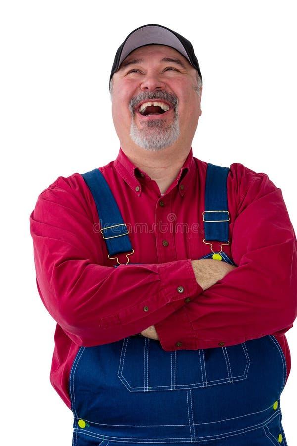 Agricoltore di mezza età gioviale che gode di buona risata fotografie stock libere da diritti