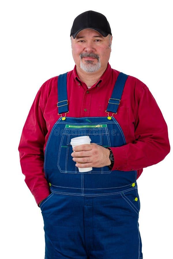 Agricoltore o lavoratore premuroso che tiene un caffè fotografie stock