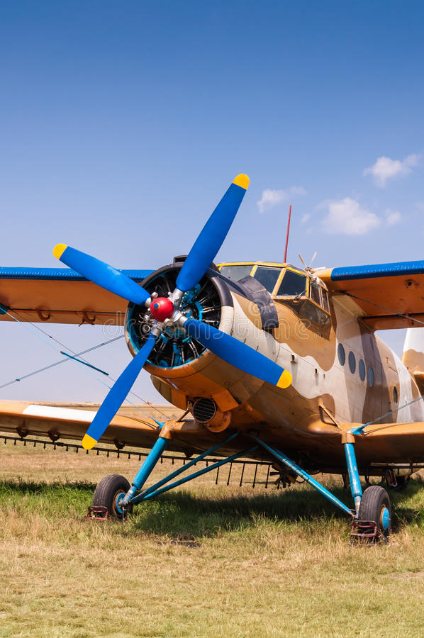 Agricultural aircraft on grass copy space