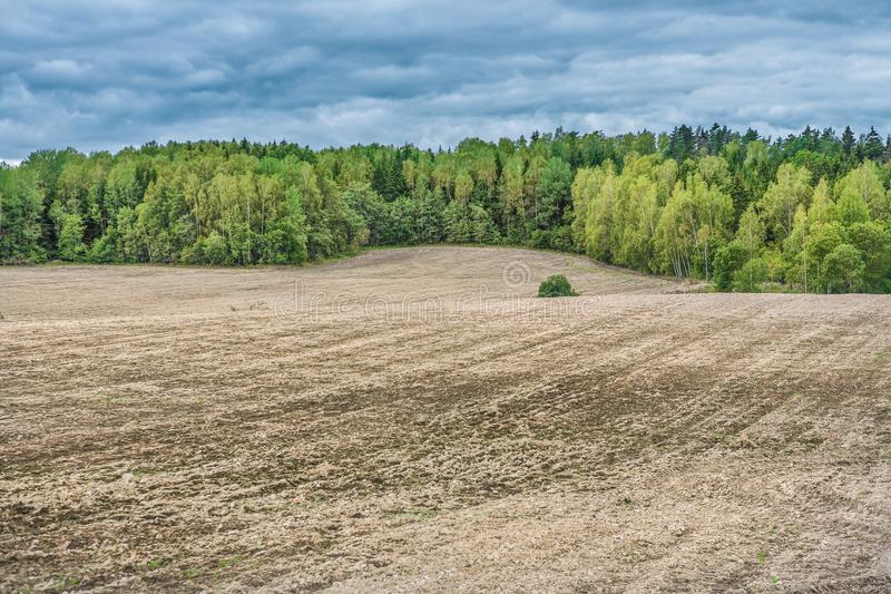 Agricultural countryside rural view ploughed field and soil royalty free stock photo