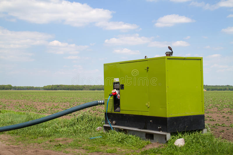 Agricultural diesel pump and hose. Diesel pump and hose for irrigating farmland royalty free stock images