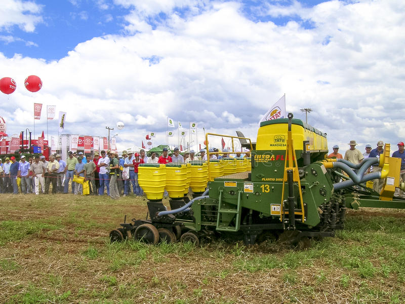 Agricultural fair. Rio Verde, Goias, Brazil, March 31, 2004:: Agricultural fair, including displays of tractors and agricultural machinery, crowded with farmers stock images