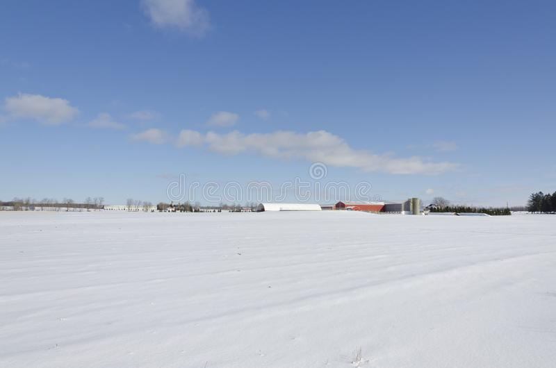 Agricultural farm and field under snow stock images