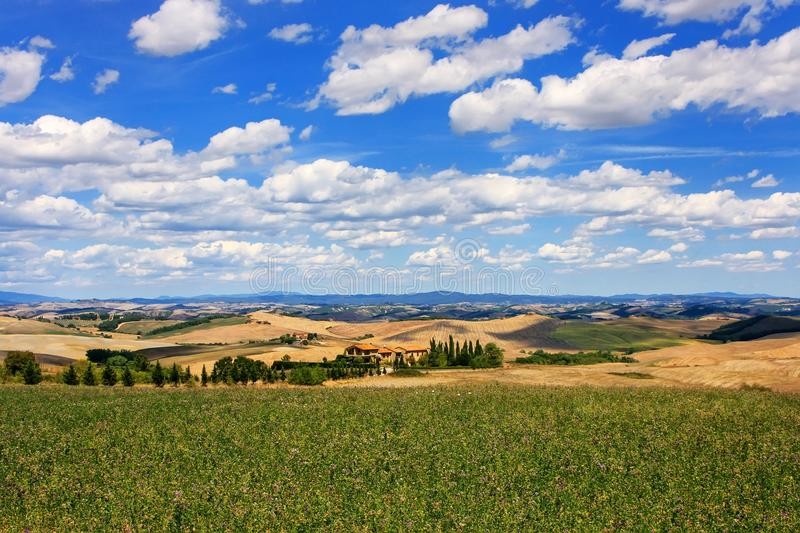 Agricultural fields of Val d`Orcia in Tuscany, Italy. In 2004 the Val d'Orcia was added to the UNESCO list of World Heritage Sites royalty free stock photos