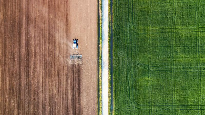 Agricultural landscape from air. Farm machine on the field. Harvesting on the field. Road through the field. Top view from flying. Drone. Agriculture-image royalty free stock photos