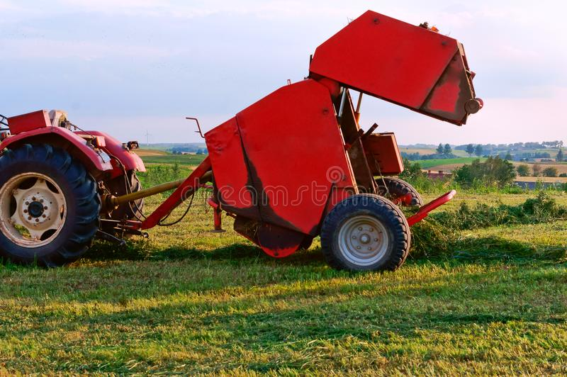 Agricultural machine for gathering hay and straw, stacker differently, harvester royalty free stock photography
