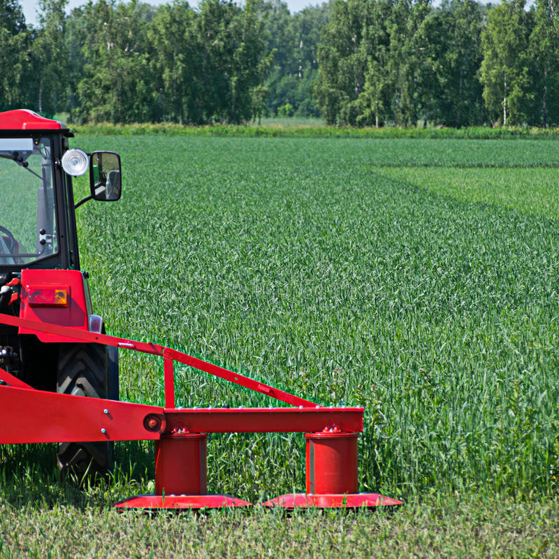 Agricultural machinery ready to cultivate. The fields stock images