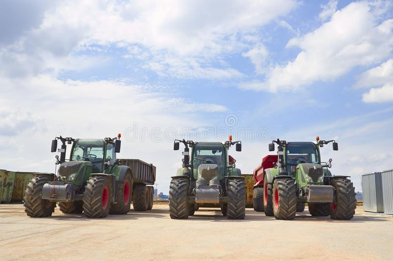 Agricultural machinery. Three heavy industrial tractors view. Standing in a row royalty free stock photo