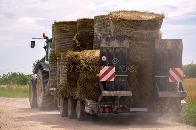 Agricultural old machinery transporting dry hay bales stock photos
