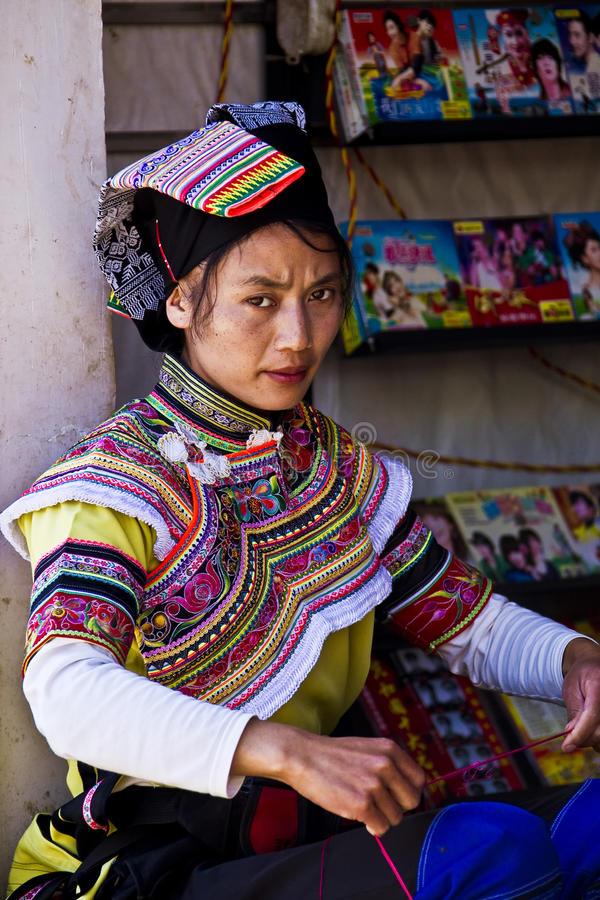 Agricultural products market in Yunnan China. Farmers are wearing traditional ethnic costumes, with agricultural products to the fair trade,the female stock photo