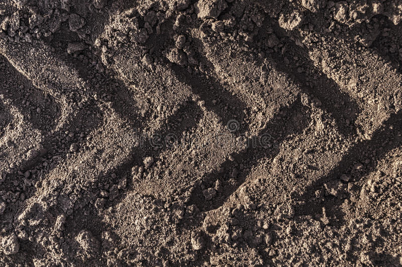 Agricultural tractor tyre track stock photo