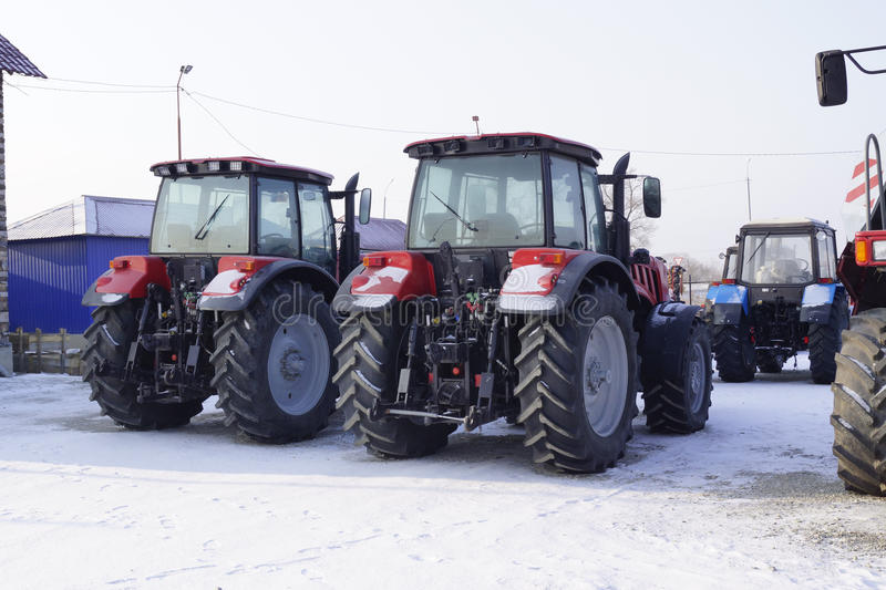 Agricultural tractors in winter storage stock images