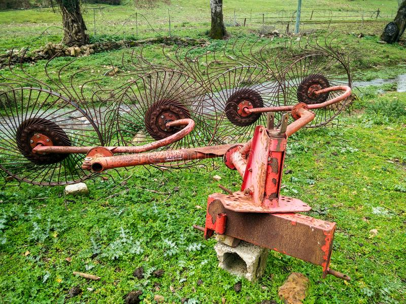 Agriculture. Agricultural mechanical tools for haymaking. Swather. Old Four-star rotary rake. This mechanical device, dragged by a tractor, is used to collect stock photos