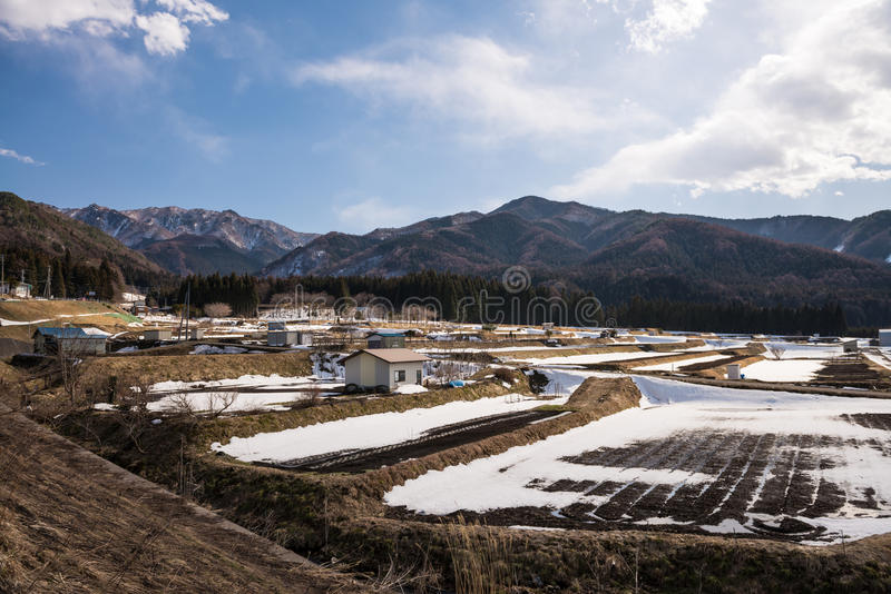 Agriculture area during winter. With mountain background in Yudanaka, Nagano stock photos