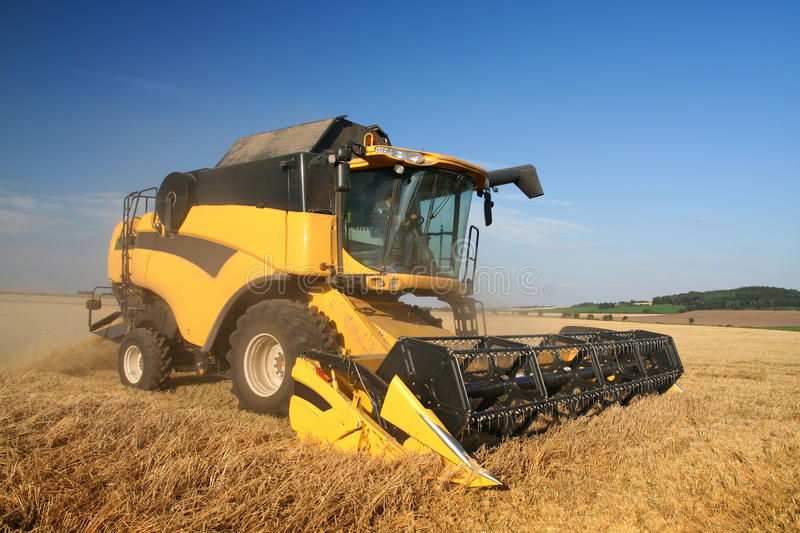 Agriculture - Combine. (harvester) on the field stock photos