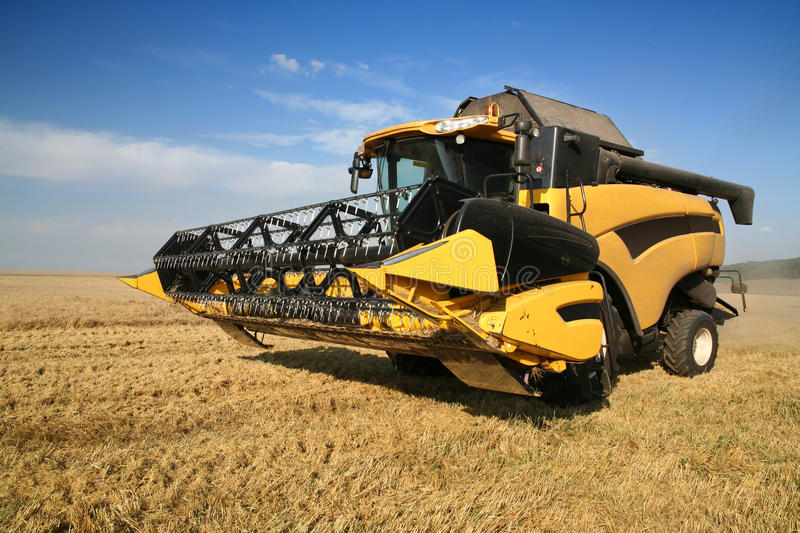 Agriculture - Combine. (harvester) on the field royalty free stock images