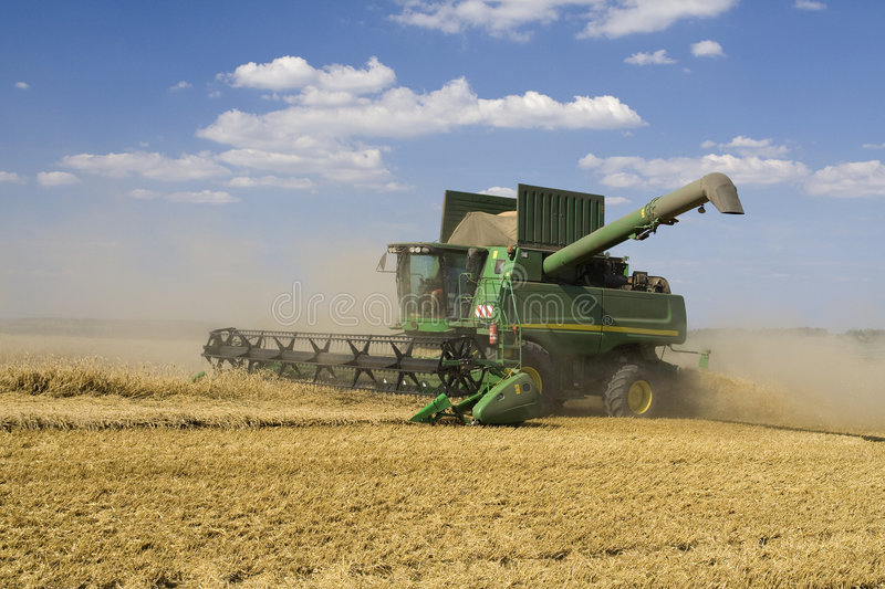 Agriculture - Combine. (harvester) on the field royalty free stock image
