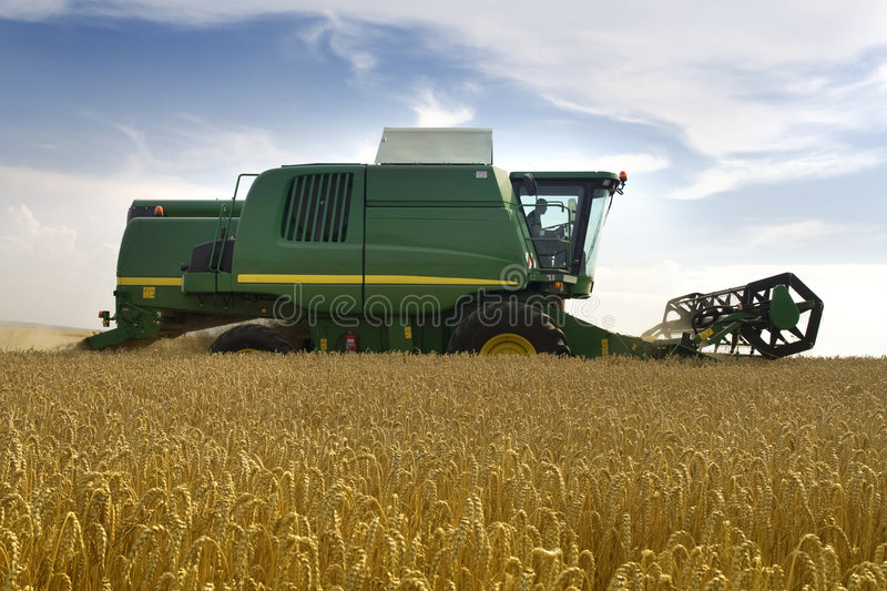 Agriculture - Combine. (harvester) on the field stock photography