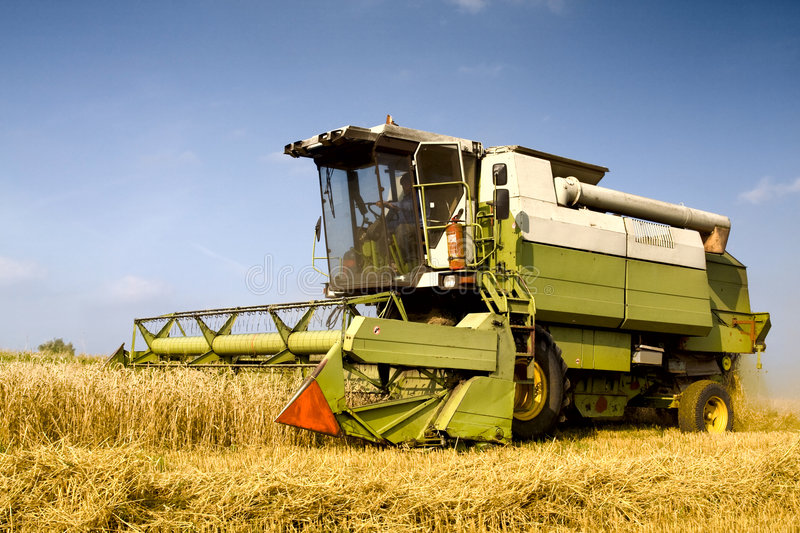 Agriculture - Combine. (harvester) on the field royalty free stock photos
