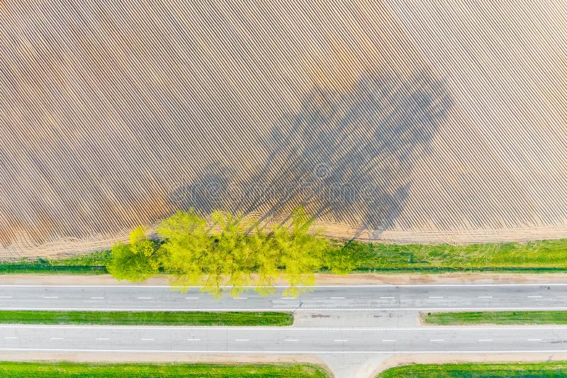 Agriculture concept. Patterned farmland in dry season. Aerial landscape stock photography