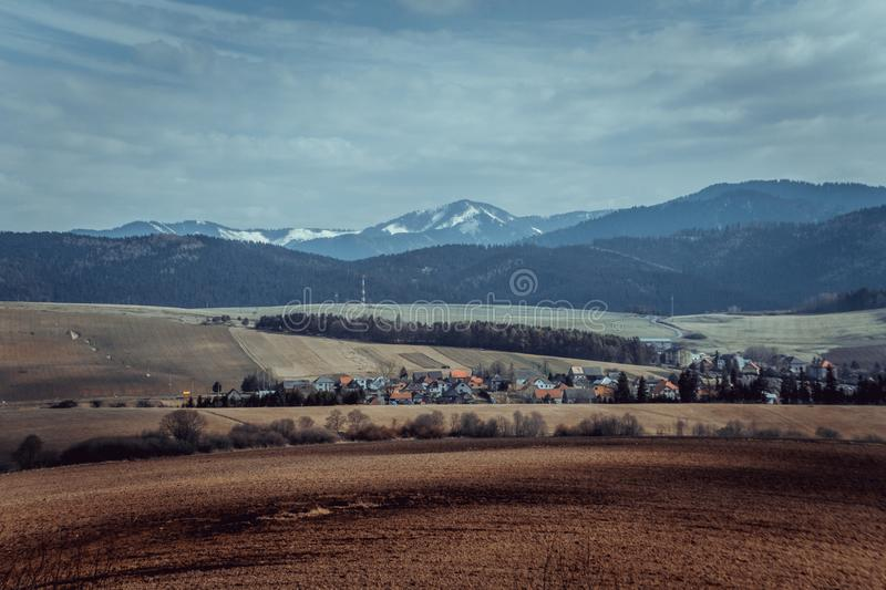Agriculture field, beautiful landscape with village and mountains. Agriculture field, beautiful landscape with village and mountains background royalty free stock photo