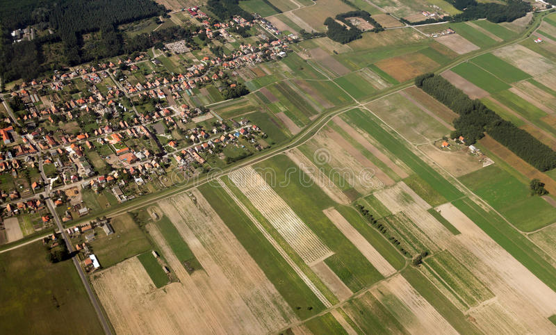 Agriculture fields seen from above. Aerial shot of agriculture fields and rural village seen from above royalty free stock photo