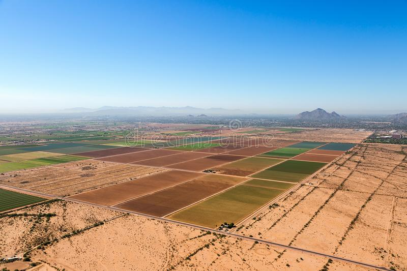 Agriculture on the outskirts of Phoenix, Arizona viewed from above. Agriculture viewed from above looking from the northeast to the southwest towards Phoenix and royalty free stock images